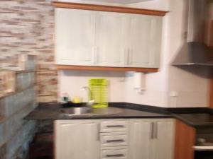 A kitchen or kitchenette at Casa De Ana