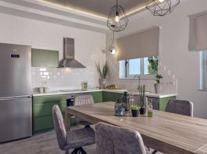 A kitchen or kitchenette at Chris & Jo Villas