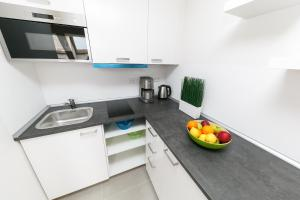 A kitchen or kitchenette at On The Top Apartments