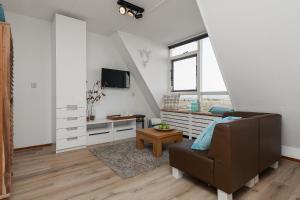 Télévision ou salle de divertissement dans l'établissement Beach House Egmond aan Zee