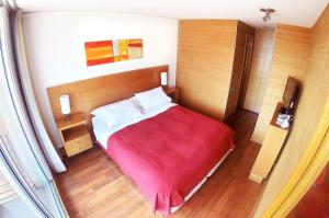 A bed or beds in a room at Austral Suites