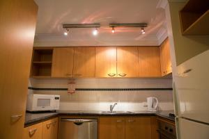 A kitchen or kitchenette at Mounts Bay Waters Apartment Hotel