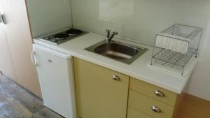 A kitchen or kitchenette at Nefeli Apartments