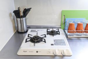 サンオリジン司にあるキッチンまたは簡易キッチン