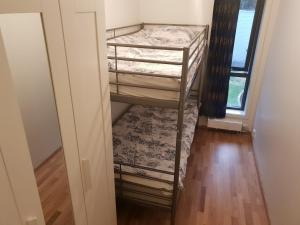 A bunk bed or bunk beds in a room at Oslo Central Apartment