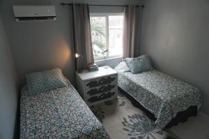 A bed or beds in a room at HumesHouse @ Blue Heaven