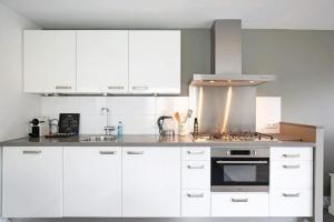 A kitchen or kitchenette at Salt Life Beachhouse