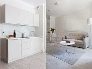 A kitchen or kitchenette at Chopin Apartments - Mennica Residence