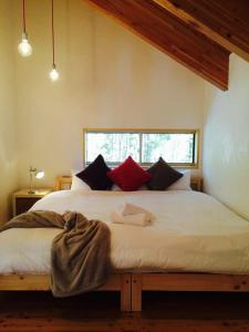 A bed or beds in a room at Fuku Chalet
