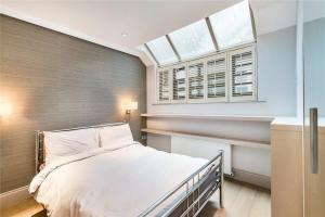 A bed or beds in a room at Luxury Apartments in Westminster