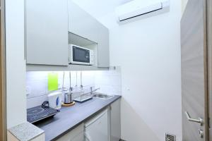 A kitchen or kitchenette at Vaci Apartments