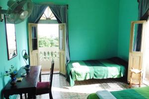 A bed or beds in a room at Atico Havana