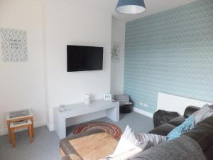 A bed or beds in a room at Valletta House Holiday Apartments