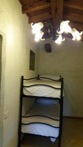 A bunk bed or bunk beds in a room at Casa Vacanze Poggio degli Ulivi