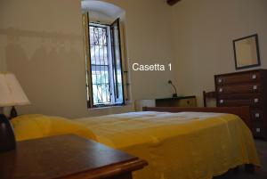 A bed or beds in a room at Casette della Masseria