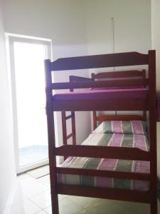 A bunk bed or bunk beds in a room at Porat apartment Povljana