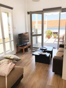 A seating area at The ROOF - Sea View Apartment in the center of Aegina town
