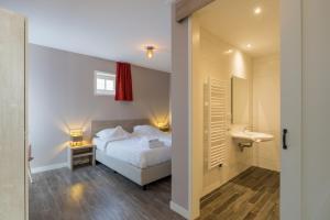 Een bed of bedden in een kamer bij De Grote Geere