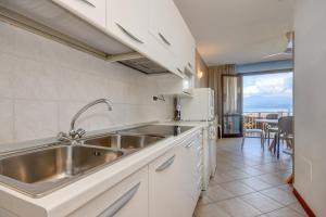 A kitchen or kitchenette at Apparthotel San Sivino