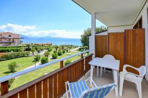 A balcony or terrace at Apparthotel San Sivino