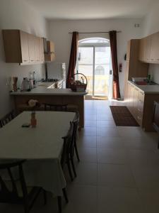 A kitchen or kitchenette at Two Bedroom Apartment Marsaskala