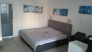 A bed or beds in a room at Calea Victoriei Residence