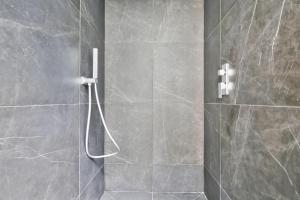 A bathroom at 69 - Authentic Parisian Home