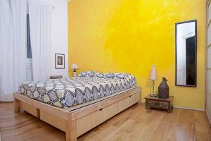 A bed or beds in a room at Casa d'artista