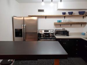 A kitchen or kitchenette at Blue Penthouse in the City