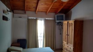 A television and/or entertainment center at Andalhue 2