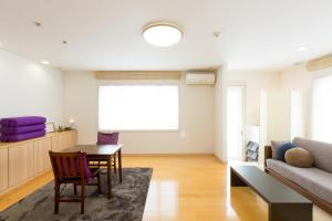 A seating area at SORA ONE STAY & YOGA