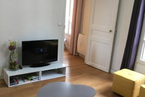 A television and/or entertainment center at Luckey Homes - Rue de l'ancienne Mairie