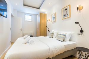 Un ou plusieurs lits dans un hébergement de l'établissement CMG Saint Germain / Jardin du Luxembourg II