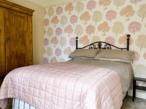 A bed or beds in a room at Church Cottage