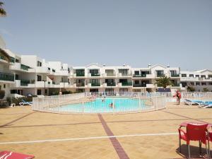 The swimming pool at or near Playa de las Cucharas Apartments