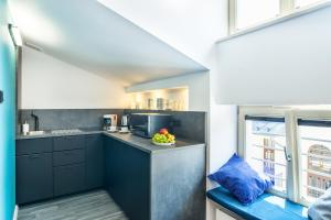 A kitchen or kitchenette at Krakow Central Apartments