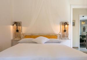 A bed or beds in a room at La Casa Di Elda