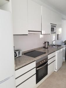 A kitchen or kitchenette at Villa Rubi