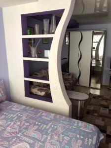 Кровать или кровати в номере Apartment on Lenina 8