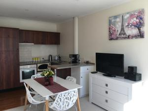 A kitchen or kitchenette at Princes Wharf Apartment Auckland City CBD