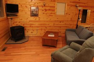 A seating area at The Cabins at Pine Haven - Beckley