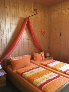 Ένα ή περισσότερα κρεβάτια σε δωμάτιο στο Ferienhaus Henriettenhof