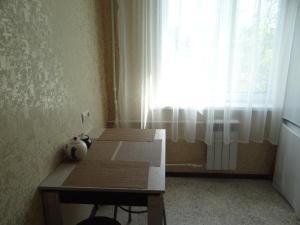 Кровать или кровати в номере Apartment on Myasishcheva 8