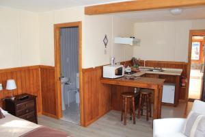 A kitchen or kitchenette at Departamentos Rossbach