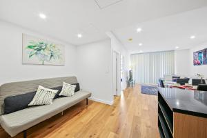A seating area at Brand new modern apartment in Leichhardt close to CBD