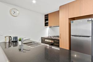 A kitchen or kitchenette at Brand new modern apartment in Leichhardt close to CBD