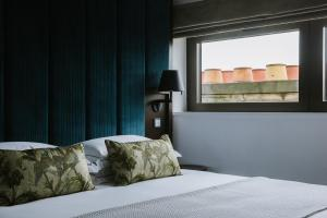 A bed or beds in a room at The Edinburgh Grand