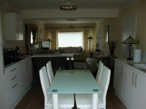 A restaurant or other place to eat at Luxury Apartment