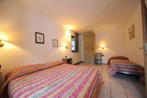 A bed or beds in a room at Residence Villa Frejus