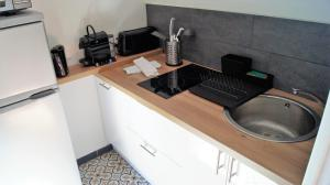 A kitchen or kitchenette at Appart Hôtel Lille Baudoin